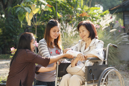 broken wrist: Young asians is take care the senior woman ,Thailand