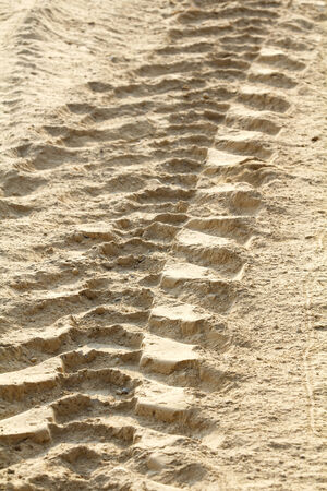 Tractor tire tracks on dirt photo