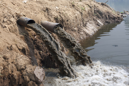 toxic waste: Water pollution in river because industrial not treat water before drain
