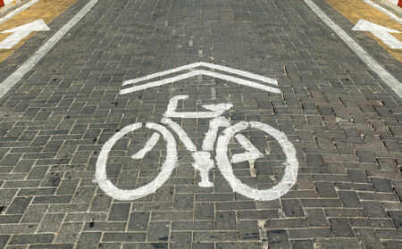 Bicycle lane sign on street photo