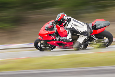cornering: Motorcycle practice leaning into a fast corner on track