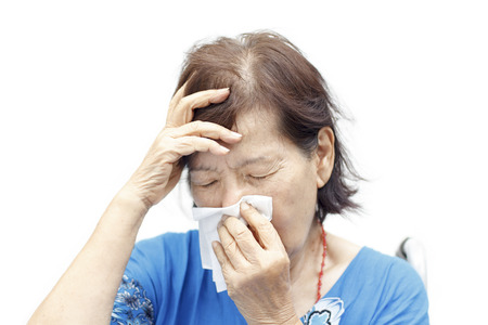 asian senior woman suffering from headache and cold