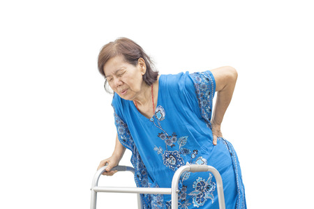 Asian senior woman holding her walker with back pain