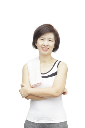 Healthy fitness middle aged asian woman  photo