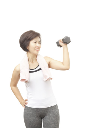 Healthy fitness middle aged asian woman smiling happy lifting weight