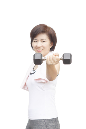 Healthy fitness middle aged asian woman happy lifting weight  Stock Photo