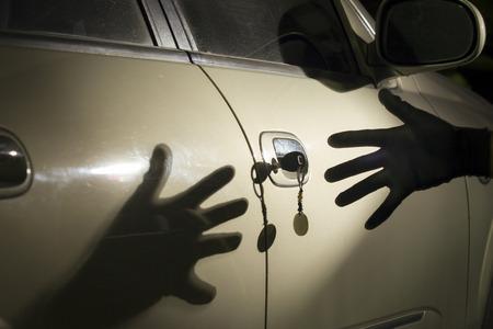 Car thief at parking lot  photo