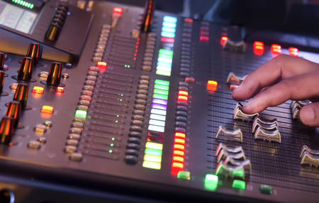 Adjust sound mixer switch in concert  Stock Photo