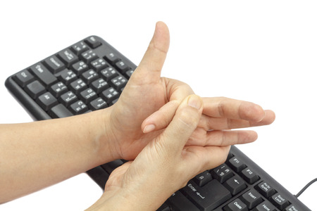 Painful finger due to prolonged use of keyboard and mouse   Stock Photo