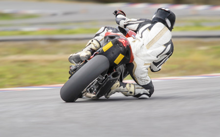motor bike: Motorcycle practice leaning into a fast corner on track