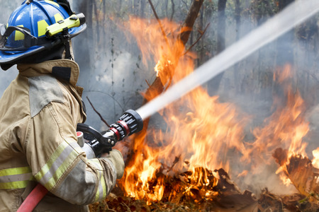 fire damage: firefighters helped battle a wildfire  Stock Photo