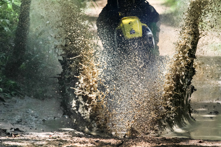 motocross: Motocross bike crossing creek, water splashing