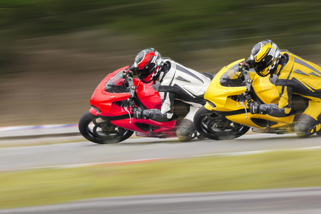 race track: Two motorcycle in curve road. Stock Photo