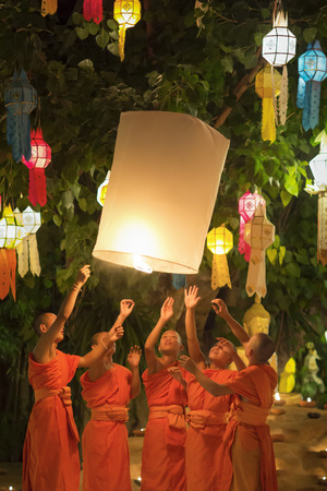 yeepeng: CHIANG MAI THAILAND - NOVEMBER 9 : Yee-Peng festival is an important culture in Thailand, Buddhist monk light candles and released lantern to the Buddha. Nov 9,2014 in Phan Tao Temple, Chiangmai, Thailand.