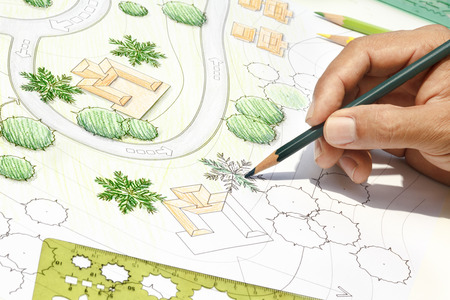 planting a tree: Landscape Architect Designing on site analysis plan