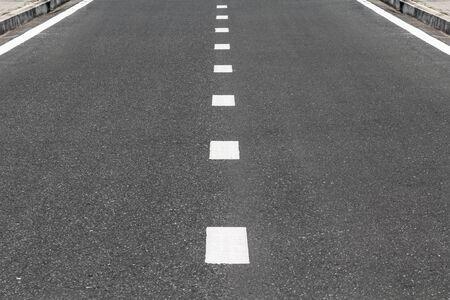 dividing: Dividing line on surface street.