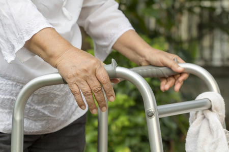 hinder: Elderly woman using a walker