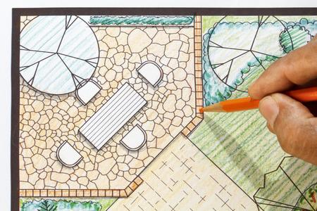 Landscape architect design patio in backyard garden plan. Imagens