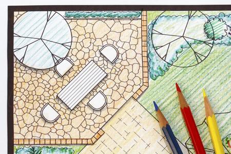 Backyard garden plan with stone patio photo