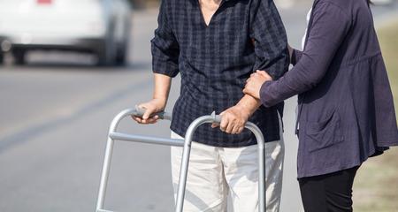 enior woman using a walker cross street Banco de Imagens - 36865119