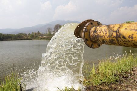 fill in: Pump water fill in reservoir , storage before drought in summer Stock Photo
