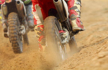 motocross: motocross racer accelerating speed in track Stock Photo