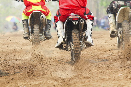 bicycle race: Motocross racer accelerating speed in track