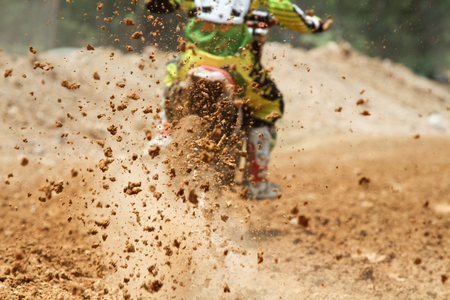 dirt bikes: Mud debris flying from a motocross race