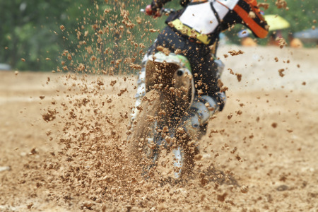 enduro: Mud debris flying from a motocross race
