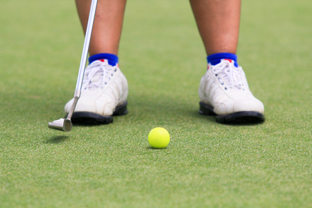 woman golf: Woman golf player putting on the green