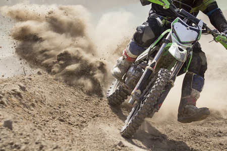 motocross: Motocross rider increase speed in track Stock Photo