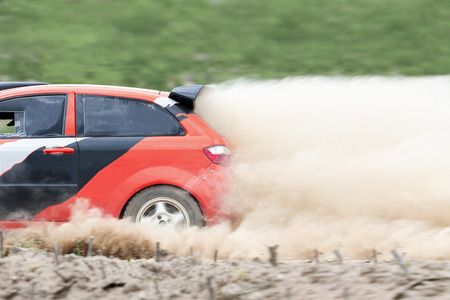 rally car: Rally car in dirt track.