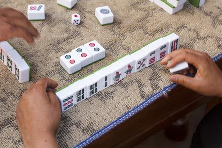 mahjong: People playing mahjong on street, Yunnan China.
