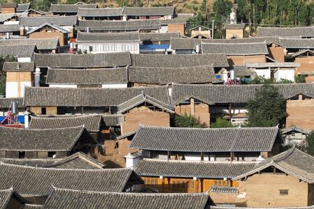 contryside: Chinese traditional roofs in rural , Yunnan China Stock Photo