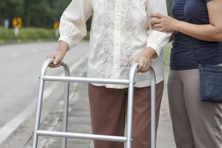 cross road: senior woman using a walker cross street