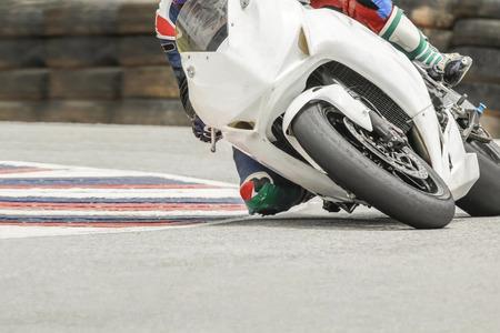 racing bike: Racing bike rider leaning into a fast corner on track