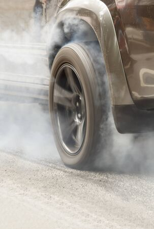 acceleration: Suv car burns rubber off its tires in preparation for the race