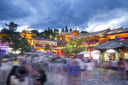 architectural heritage of the world: Lijiang old town Unesco World Heritage Site in the evening with crowd tourist, Yunnan China. Stock Photo
