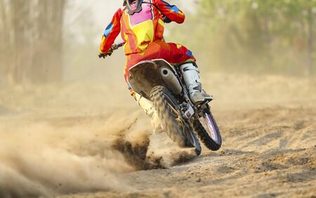 motocross: Motocross racer accelerating speed in track