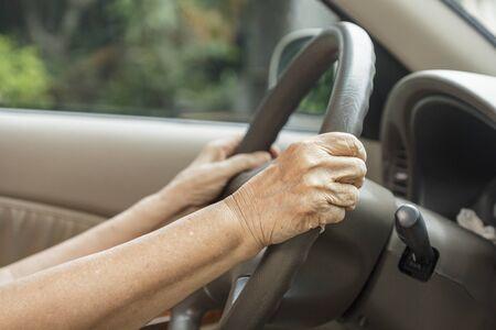 driving a car: Senior woman driving a car Stock Photo
