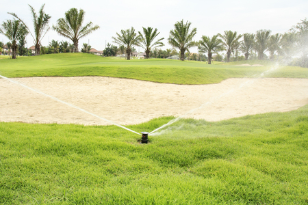 irrigation: Watering in golf course Stock Photo