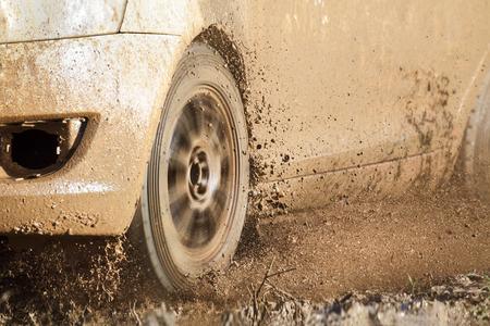 rally car: Rally car in muddy road