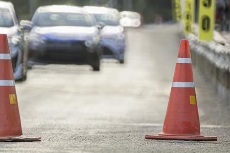 cones: orange traffic cones on the race car track