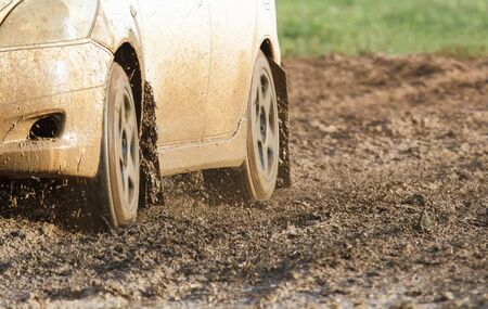 rally car: Rally car speed in muddy track. Stock Photo