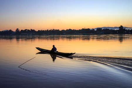 sean: Sunrise ,fisherman boat on Mekong river ,Chiang sean district ,Chiang rai ,Thailand