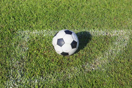 ballsport: Old soccer ball on soccer field