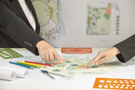 Landscape architect changing drawing at meeting with client Stock Photo - 48172777