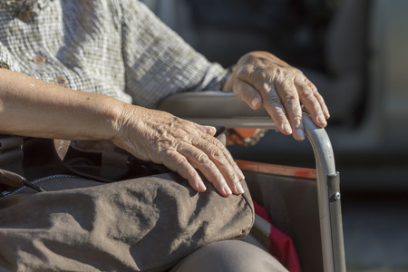 mobility nursing: Elderly woman travel with wheelchair Stock Photo