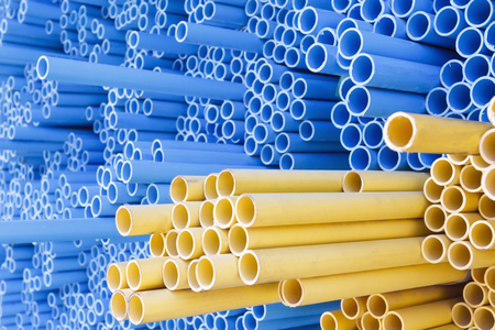 PVC pipes for electric conduit yellow and water blue