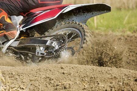 enduro: Motocross racer accelerating speed in track